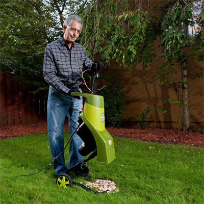Old Man with Safety Glasses and Wood Chipper