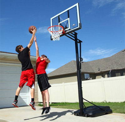 Couple playing at Basketball Hoop