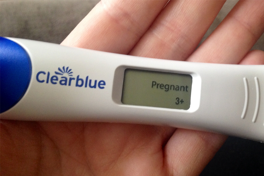 positive pregnancy test clear blue black hand