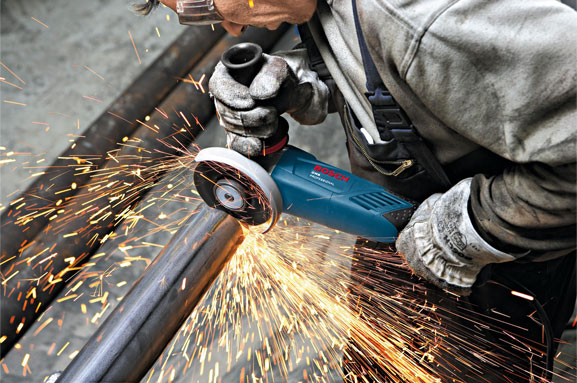 Angle Grinder polishing the Metal