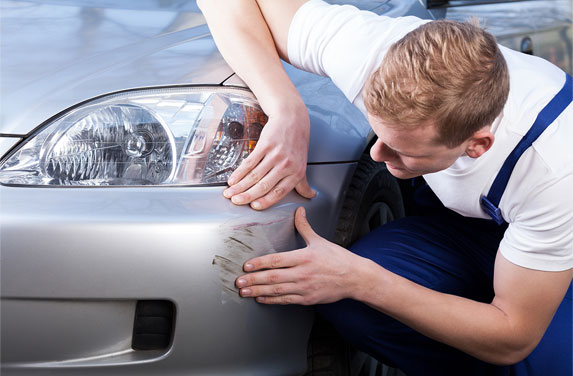 Car Scratch Repair by Mechanic