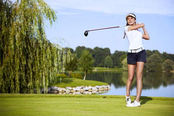 Women Playing with Golf Driver